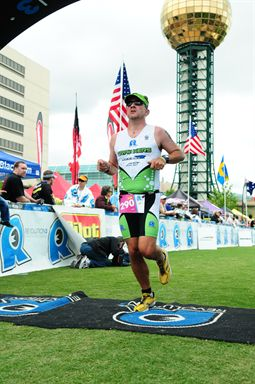 Crossing the finish line at the 2011 Rev3 Knoxville.  Awesome finish line!